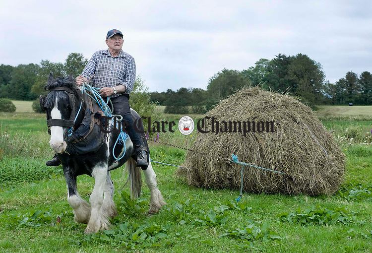 Ger Smyth slinging the hay on his farm in Feakle. Photograph by Declan Monaghan