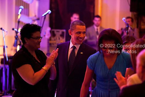 """United States President Barack Obama and First Lady Michelle Obama host a celebration of American poetry and prose in the East Room of the White House in Washington, DC, USA, on 11 May, 2011. Conservatives have criticized the White House for inviting the rapper Common to the event. Their objection stems from a 2007 YouTube video in which Common says """"tell the law, my Uzi weighs a ton"""" as well as """"Burn a Bush cos' for peace he no push no button."""".Credit: Jim LoScalzo / Pool via CNP"""