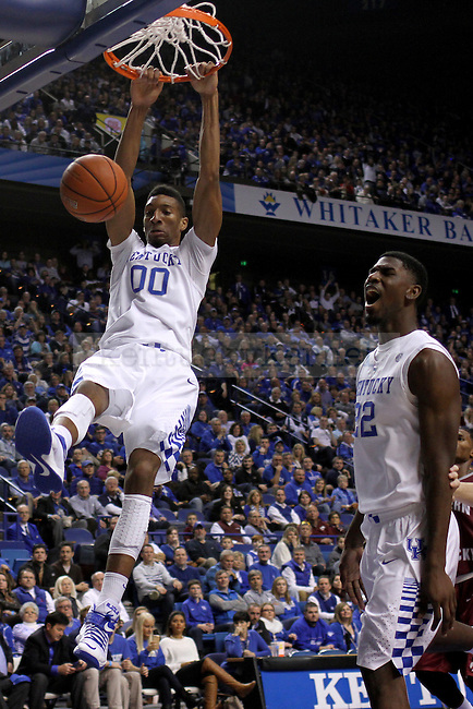 UK forward Marcus Lee (00) dunks the ball during the second half of the University of Kentucky men's basketball game vs. Eastern Kentucky University at Rupp Arena in Lexington, Ky., on Sunday, December 7, 2014. UK won 82 - 49. Photo by Tessa Lighty | Staff