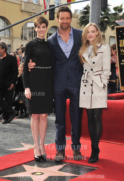Hugh Jackman with his Les Miserable co-stars Anne Hathaway (left) & Amanda Seyfried. Jackman was honored with the 2,487th star on the Hollywood Walk of Fame..December 13, 2012  Los Angeles, CA.Picture: Paul Smith / Featureflash