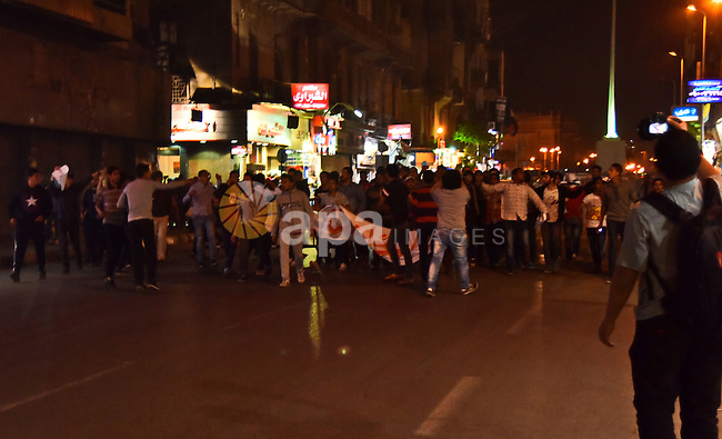 Members of Ultras Nahdawy groupe, who are supporters of the Muslim Brotherhood and ousted President Mohamed Morsi, light flares and shout slogans during a demonstration against the military and interior ministry at Tahrir square, in Cairo on April 23, 2015. Photo by Amr Sayed