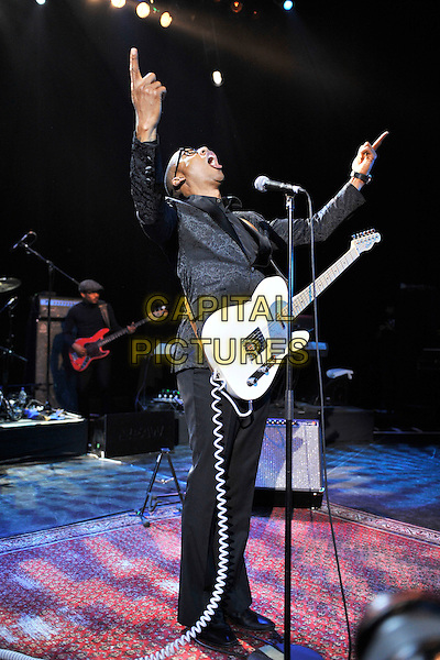 RAPHAEL SAADIQ.Performing live at Shepherds Bush Empire, London, England..April 28th, 2011.stage concert live gig performance music full length singing glasses hands arms in air mouth open guitar black jacket suit trousers.CAP/MAR.© Martin Harris/Capital Pictures.