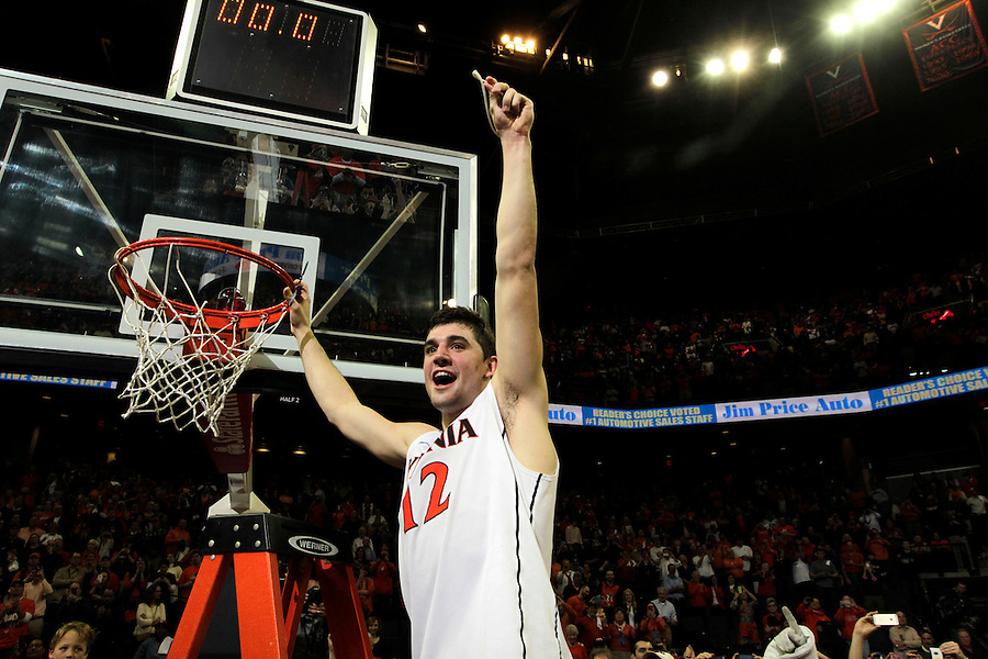 Virginia guard Joe Harris (12) cuts his piece of net to celebrate winning the ACC title after defeating Syracuse 75-56 in an NCAA basketball game Saturday March 1, 2014 in Charlottesville, VA. Photo/Andrew Shurtleff