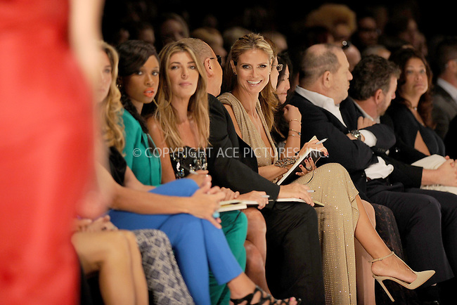 WWW.ACEPIXS.COM . . . . . .September 7, 2012...New York City.....Model Heidi Klum, designer Michael Kors, singer Jennifer Hudson and Nina Garcia watch the runway at the Project Runway Spring 2013 fashion show during Mercedes-Benz Fashion Week on September 7, 2012 ...Please byline: KRISTIN CALLAHAN - ACEPIXS.COM.. . . . . . ..Ace Pictures, Inc: ..tel: (212) 243 8787 or (646) 769 0430..e-mail: info@acepixs.com..web: http://www.acepixs.com .