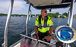WINSTED,  CT-071919JS03--  Winsted police officer Greg Lopardo patrols Highland Lake in Winsted on Saturday afternoon. The Winsted Police Department has increased its presence patrolling Highland Lake. Eight police officers, including Lopardo, are now trained and certified to be part of the marine patrol. <br /> Jim Shannon Republican American
