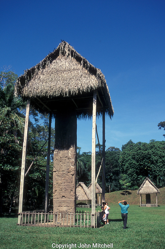 Visitors looking ip at Stela E, the tallest stela in the Mayan world, Quirigua archaeological site, Guatemala