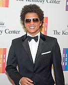 Bruno Mars arrives for the formal Artist's Dinner honoring the recipients of the 2014 Kennedy Center Honors hosted by United States Secretary of State John F. Kerry at the U.S. Department of State in Washington, D.C. on Saturday, December 6, 2014. The 2014 honorees are: singer Al Green, actor and filmmaker Tom Hanks, ballerina Patricia McBride, singer-songwriter Sting, and comedienne Lily Tomlin.<br /> Credit: Ron Sachs / Pool via CNP