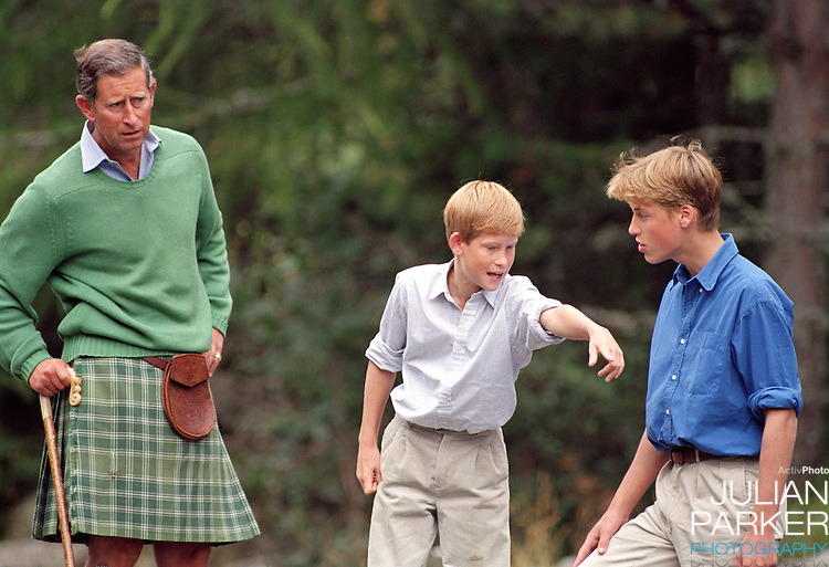 Charles, The Prince of Wales, Prince William, and Prince Harry at a Photocal on Balmoral Estate, Scotland