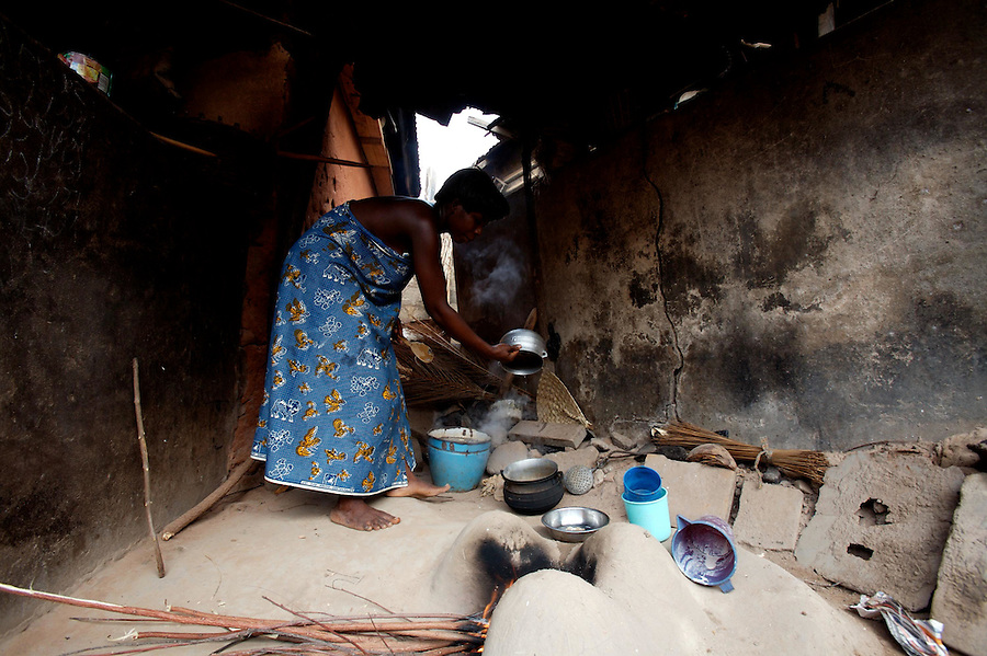 "a woman, former ""trokosi"" religious slave, cooks for her priest just outside the shrine  in Kilkor, in the Volta region, Ghana on Friday March 09 2007.."