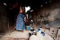 """a woman, former """"trokosi"""" religious slave, cooks for her priest just outside the shrine  in Kilkor, in the Volta region, Ghana on Friday March 09 2007.."""