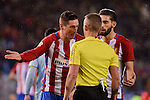 Atletico de Madrid's Fernando Torres and Yannick Carrasco talking with the referee during La Liga match between Atletico de Madrid and Celta de Vigol at Vicente Calderon Stadium in Madrid, Spain. December 03, 2016. (ALTERPHOTOS/BorjaB.Hojas)