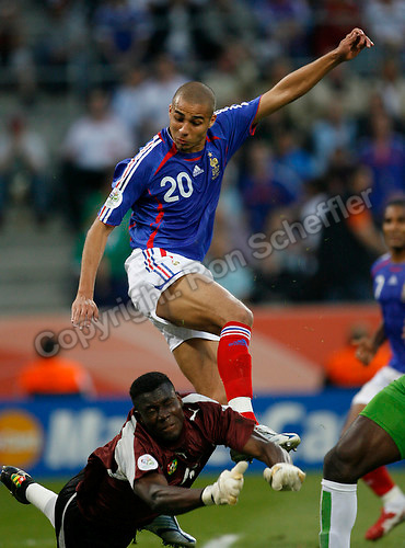 Jun 23, 2006; Cologne, GERMANY; France forward (20) David Trezeguet collides with Togo goalkeeper (16) Kossi Agassa on a failed scoring attempt during first half play in first round group G action of the 2006 FIFA World Cup at FIFA World Cup Stadium Cologne. Mandatory Credit: Ron Scheffler-US PRESSWIRE Copyright © Ron Scheffler.