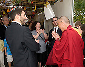 Washington, DC - October 10, 2009 -- The Dalai Lama (right) visits a ritual sukkah in Washington, DC Saturday, marking the end of the Jewish tabernacle holiday Sukkot. The Dalai Lama told the assembled members of Adas Israel Congregation, including its rabbi Gil Steinlauf (left), Cantor and Ritual Director Jenna Greenberg (left center), and  Cantor Jeffrey Weber (right center), that he had much to learn from the Jews and their ability to survive so many generations in a diaspora. .Credit: Ron Sachs / CNP
