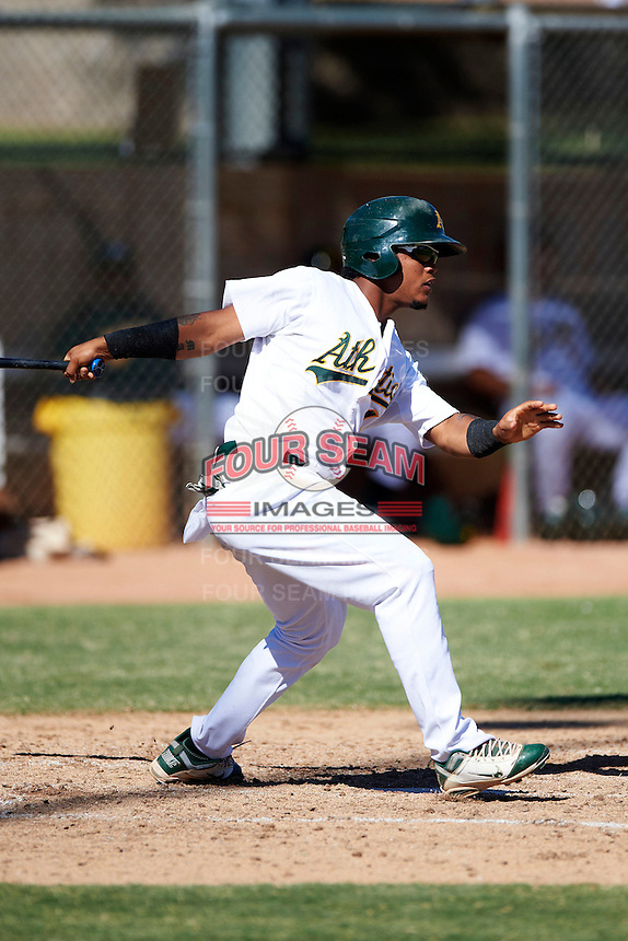 Oakland Athletics minor league outfielder Vicmal De La Cruz #4 during an instructional league game against the San Francisco Giants at the Papago Park Baseball Complex on October 17, 2012 in Phoenix, Arizona. (Mike Janes/Four Seam Images)