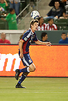 CARSON, CA – APRIL 30, 2011: Chivas USA defender Andrew Boyens heads the ball during the match between Chivas USA and New England Revolution at the Home Depot Center, April 30, 2011 in Carson, California. Final score Chivas USA 3, New England Revolution 0.