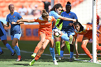 Houston, TX - Saturday May 13, 2017: Sky Blue FC midfielder Raquel Rodriguez (11) clears the ball away from the goal as Houston Dash midfielder Amber Brooks (12) attempts to score during a regular season National Women's Soccer League (NWSL) match between the Houston Dash and Sky Blue FC at BBVA Compass Stadium. Sky Blue won the game 3-1.