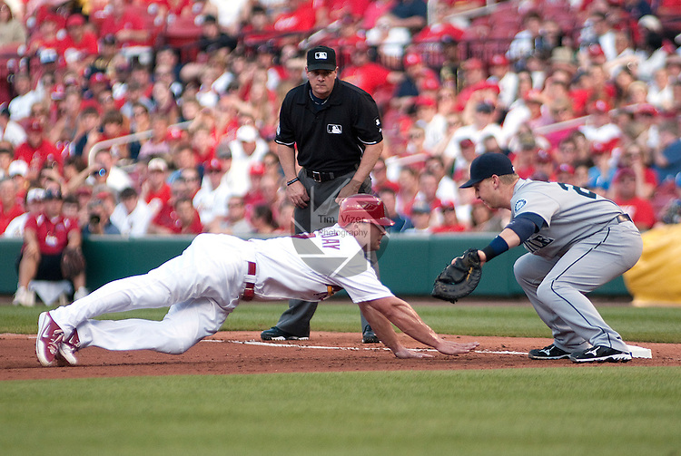 June 14, 2010          St. Louis Cardinals left fielder Matt Holliday (7) dives safely back to first base as the pitcher tries to pick him off, throwing to Seattle Mariners first baseman Mike Carp (20) in the third inning.  First base umpire is Marty Foster.  The St. Louis Cardinals defeated the Seattle Mariners 9-3 in the first game of a three-game homestand at Busch Stadium in downtown St. Louis, MO on Monday June 14, 2010.