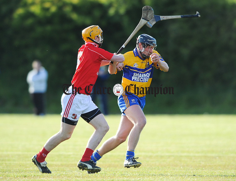 Cian Dillon of Crusheen in action against Shane Golden of Sixmilebridge during their Clare Champion Cup game at Crusheen. Photograph by John Kelly.