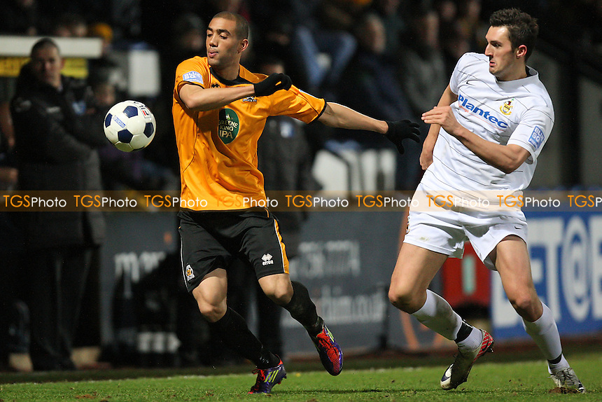 Ashley Carew of Cambridge evades Andy Owens - Cambridge United vs Southport - Blue Square Conference Football at the Abbey Stadium, Cambridge - 05/01/12 - MANDATORY CREDIT: Gavin Ellis/TGSPHOTO - Self billing applies where appropriate - 0845 094 6026 - contact@tgsphoto.co.uk - NO UNPAID USE.