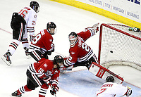 Nebraska-Omaha's Terry Broadhurst beats St. Cloud State goalie Ryan Faragher with the game-winning goal in the third period. Nebraska-Omaha defeated St. Cloud State 4-3 Saturday night at CenturyLink Center in Omaha. (Photo by Michelle Bishop) .