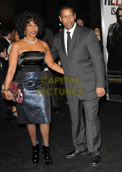 "PAULETTA & DENZEL WASHINGTON .at Alcon Entertainment's L.A. Premiere of ""The Book of Eli"" held at The Chinese Theatre in Hollywood, California, USA,  January 11th 2010..full length black and blue shiny dress grey gray suit tie married couple husband wife ankle boots patent clutch bag pink beaded red jewelled jewel encrusted pattern patterned .CAP/RKE/DVS.©DVS/RockinExposures/Capital Pictures."