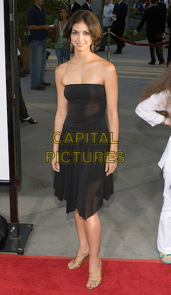 "MORENA BACCARIN.""The 40 Year-Old Virgin"" Premiere,.held at The Arclight Cinema,.Los Angeles, 11th August 2005.full length black strapless dress green bead dangling earrings gold strappy sandals shoes.www.capitalpictures.com.sales@capitalpictures.com.© Capital Pictures."