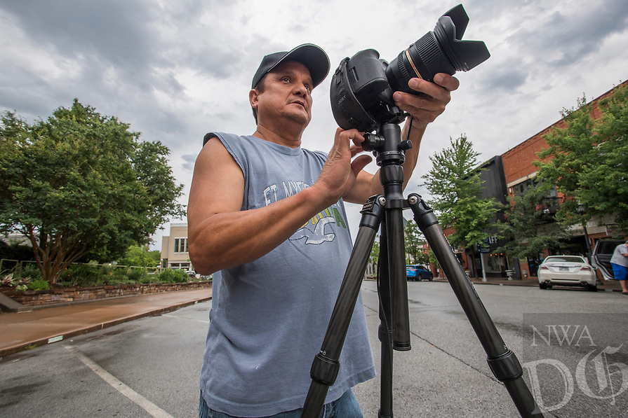 NWA Democrat-Gazette/J.T. WAMPLER Jay Stout of Fayetteville sets his camera on a tripod Sunday June 18, 2017 while taking photographs between thunderstorms of the Fayetteville square. Stout, a longtime Fayetteville resident, takes his camera all over town photographing landscapes and buildings.