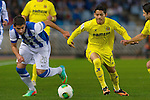 Real Sociedad's Jose Angel Valdes (l) and Villareal's Javier Aquino during Copa del Rey match.November 23,2013. (ALTERPHOTOS/Mikel)
