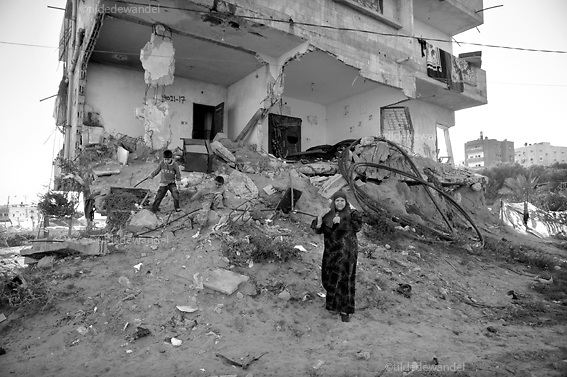 2010 November 2 - Beitlahya - Gaza<br /> Woman and her children in front of their house which got badly destroyed during operation 'Cast Lead', the Israeli attack on Gaza during the winter of 2008-2009. The family still lives in the house as they have no other place to go.