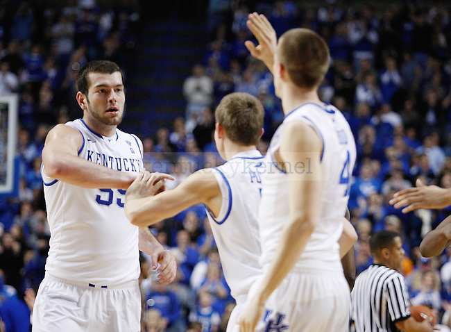 Josh Harrellson gets high fives from Jarod Polson and Jon Hood during the second half of the UK men's basketball 85-79 win over Mississippi State at Rupp Arena on Tuesday, Feb. 15, 2011.  Photo by Britney McIntosh | Staff