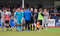 Grimsby manager Russell Slade questions referee Mark Heywood on the pitch at full time of the Sky Bet League 2 match between Cheltenham Town and Grimsby Town at the The LCI Rail Stadium,  Cheltenham, England on 17 April 2017. Photo by PRiME Media Images / Mark Hawkins.