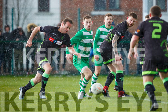 Peter McCarthy, Killarney Celtic takes on the North End defence and the hailstone during their FAI cup clash in Killarney on Sunday.