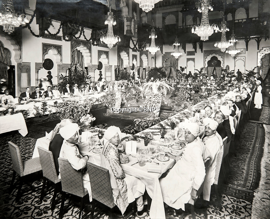 BNPS.co.uk (01202 558833)<br /> Pic: PhilYeomans/BNPS<br /> <br /> Maharaja's attending a lavish banquet in Ooty.<br /> <br /> Last Days of the Raj - A fascinating family album from one of the last Viceroy's of India reveal Britain's 'Jewel in the Crown' in all its splendour.<br /> <br /> The family album of Viscount George Goschen has been unearthed after 90 years, and provide's an amazing snapshot of the pomp and pageantry of a wealthy and powerful British family in India in the 1920s and 30's.<br /> <br /> They show the Governor of Madras and his family enjoying a lavish lifestyle of parades, banquets and hunting and horse racing in the last decades of the Raj.<br /> <br /> At the time, Gandhi was organising peasants, farmers and labourers to protest against excessive land-tax and discrimination. <br /> <br /> The album consists of some 300 large photographs. They have remained in the family for 90 years but have now emerged for auction following a house clearance and are tipped to sell for &pound;200.