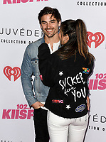 Jared Haibon (L) and Ashley Laconetti (R) at iHeartRadio KIIS FM Wango Tango at the Dignity Health Sports Park.