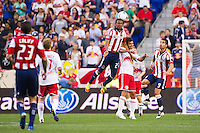 Jose Erick Correa (27) of CD Chivas USA goes up for a header over Rafa Marquez (4) of the New York Red Bulls. The New York Red Bulls and CD Chivas USA played to a 1-1 tie during a Major League Soccer (MLS) match at Red Bull Arena in Harrison, NJ, on May 23, 2012.