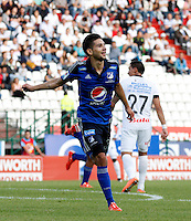 MANIZALES - COLOMBIA -01-04-2015: Jonathan Agudelo, jugador Millonarios celebra el gol anotado al Once Caldas durante partido aplazado entre Once Caldas Millonarios por la fecha 3 por de la Liga Aguila I 2015, jugado en el estadio Palogrande de la ciudad de Manizales.  / Jonathan Agudelo, player of Millonarios celebrates a scored goal to Once Caldas during a postponed match betwen Once Caldas and Millonarios for the date Millonarios for the Liga Aguila I 2015 at the Palogrande stadium in Manizales city. Photo: VizzorImage / Santiago Osorio / Str.