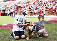 Young MSU fans posing with Bully during Maroon and White football game.<br />  (photo by Lizzy Powers / &copy; Mississippi State University)