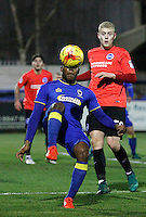 AFC Wimbledon's Dom Polen flicks the ball back into the box during the The Checkatrade Trophy match between AFC Wimbledon and Brighton & Hove Albion Under 21s at the Cherry Red Records Stadium, Kingston, England on 6 December 2016. Photo by Carlton Myrie / PRiME Media Images