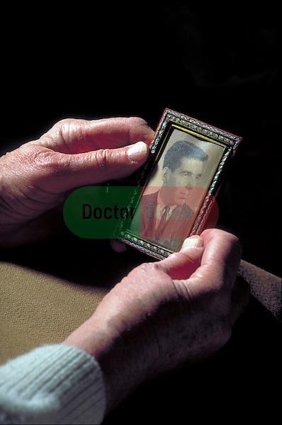 elder hands holding photograph