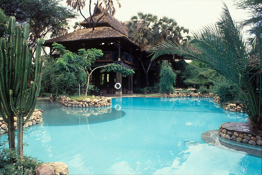 The  Safari Lodge  hotel  run  by the Block Hotel Group whose water  for the  pool  is  drawn from the Samburu villages' water  source.  .. In times of  water  shortage this has  caused  death from lack of water in the Samburu  community.    Maralal.  Northern Kenya...