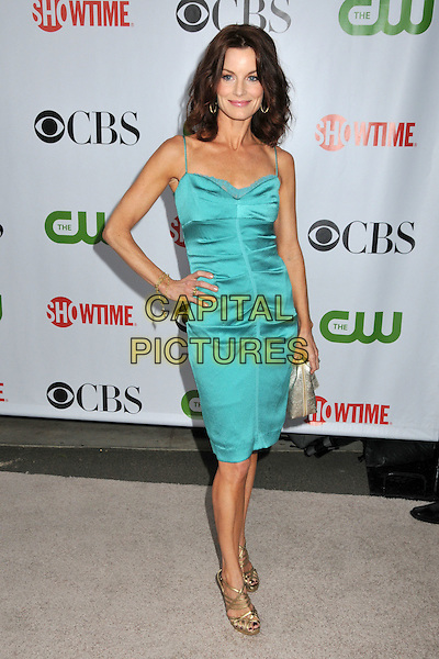 LAURA LEIGHTON.CBS, CW and Showtime TCA Press Tour Party 2009 held at the Huntington Library, Pasadena, CA, USA..August 3rd, 2009.full length green teal dress ruched gold sandals hand on hip silver clutch bag .CAP/ADM/BP.©Byron Purvis/AdMedia/Capital Pictures.