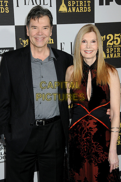 MICHAEL A. SIMPSON & JUDY CAIRO.25th Annual Film Independent Spirit Awards - Arrivals held at the Nokia Event Deck at L.A. Live, Los Angeles, CA, USA, 5th March 2010..indie arrivals half length black grey gray shirt suit red lace dress cleavage cut out .CAP/ADM/BP.©Byron Purvis/AdMedia/Capital Pictures.