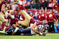 Landover, MD - November 18, 2018: Houston Texans quarterback Deshaun Watson (4) is sacked by Washington Redskins defensive end Matthew Ioannidis (98) during second half action of game between the Houston Texans and the Washington Redskins at FedEx Field in Landover, MD. The Texans defeated the Redskins 23-21. (Photo by Phillip Peters/Media Images International)