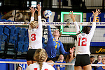 BROOKINGS, SD - SEPTEMBER 4:  Ashlynn Smith #4 from South Dakota State tries to get a kill past Erica Haslag #3 and Kathryn Graf #12 from Bradley in their match Sunday afternoon at Frost Arena in Brookings. (Photo by Dave Eggen/Inertia)