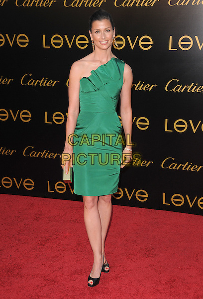 BRIDGET MOYNAHAN .The 3rd Annual Leveday Hosted by Cartier held at a private estate in Bel Air, California, USA..June 18th, 2008.full length dress gold green one shoulder black shoes gold clutch bag .CAP/DVS.©Debbie VanStory/Capital Pictures.