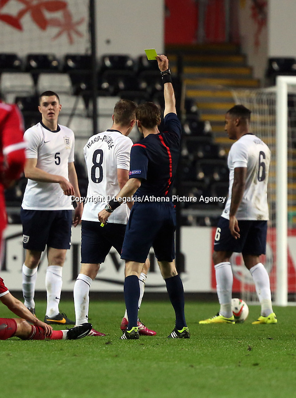 Pictured: Match referee Artyom Kuchin shows James Ward-Prowse of England (8) a yellow card. Monday 19 May 2014<br /> Re: UEFA Euro Under-21 Qualifier, Wales v England at the Liberty Stadium, Swansea, south Wales, United Kingdom