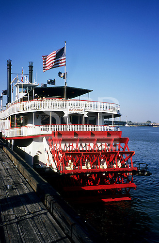 New Orleans, USA. Paddle steamer 'Natchez' moored on Mississippi River in New Orleans with US flag flying at stern.