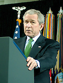 """Washington, D.C. - February 20, 2007 -- United States President George W. Bush makes remarks as he participates in the Ceremonial Swearing-in for retired Vice Admiral John Michael """"Mike"""" McConnell as the second Director of National Intelligence (DNI) in Washington, D.C. on Tuesday, February 20, 2007.  McConnell replaces John Negroponte.<br /> Credit: Ron Sachs - Pool"""