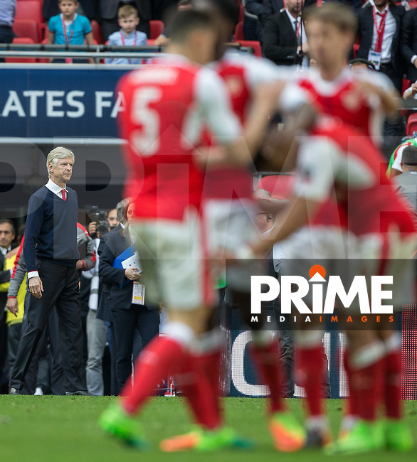 Arsenal Manager Arsene Wenger looks on as his team celebrate at full time during the FA Cup semi final match between Manchester City and Arsenal at Wembley Stadium, London, England on 23 April 2017. Photo by Andy Rowland.