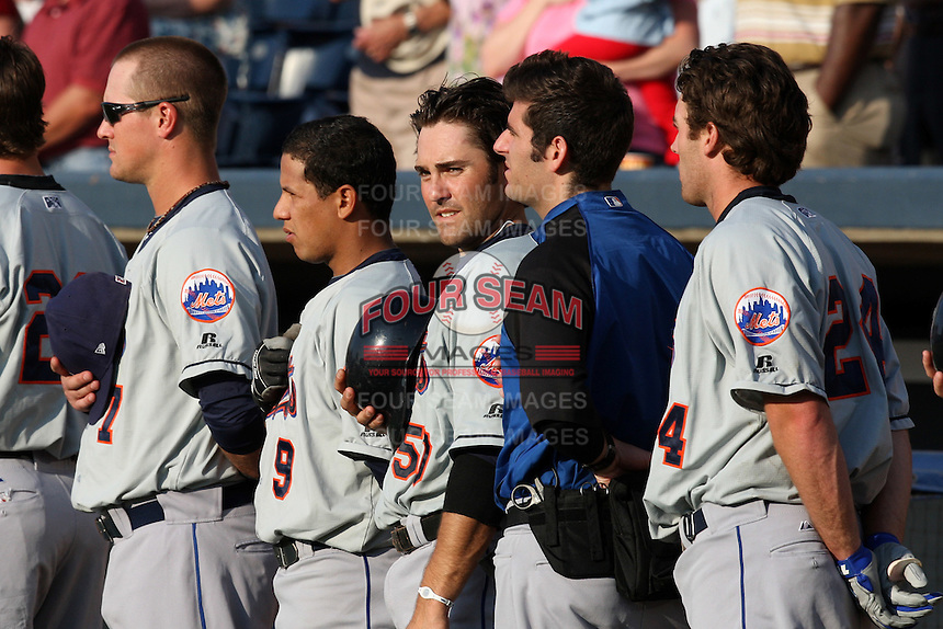Binghamton Mets Sean Ratliff (7), Luis Hernandez (9), Mike Nickeas (50), trainer, and Nick Evans (24) stand for the national anthem before  a game vs. the Akron Aeros at Eastwood Field in Akron, Ohio;  June 25, 2010.   Binghamton defeated Akron 5-3.  Photo By Mike Janes/Four Seam Images